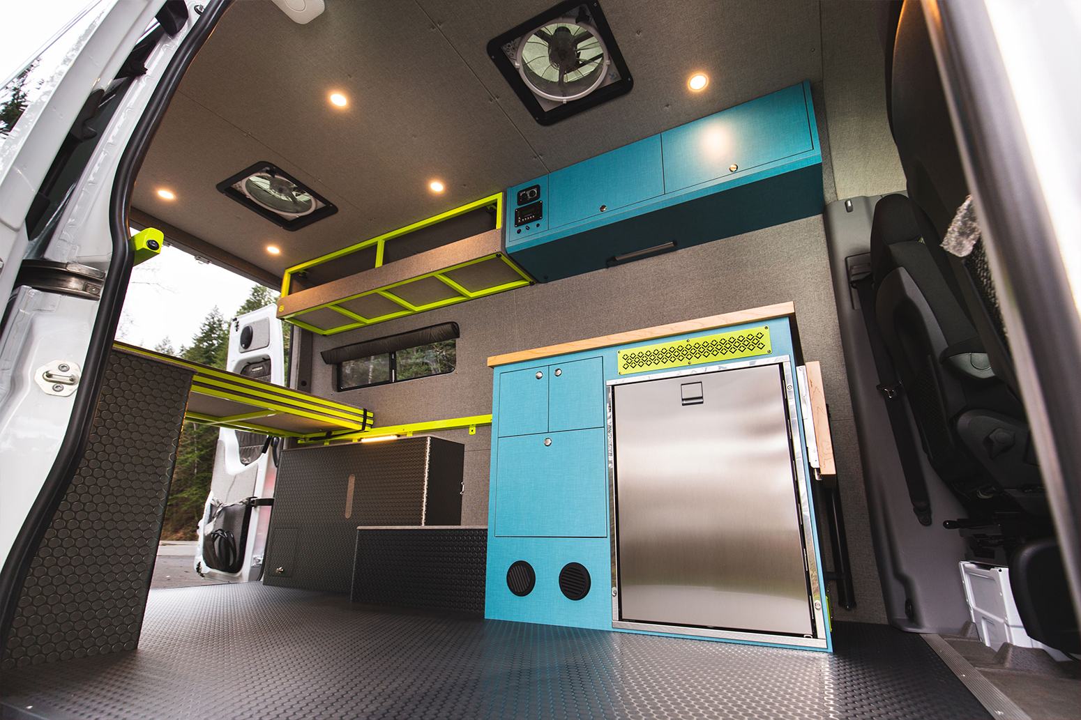 White Mercedes Sprinter van kitchen blue trimmed with green