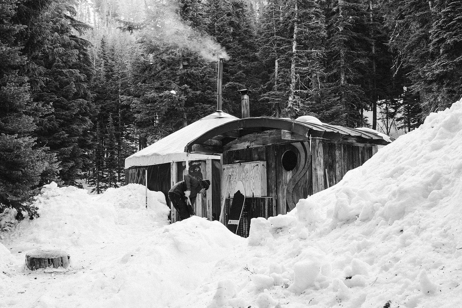 Person in snow in front of yurt