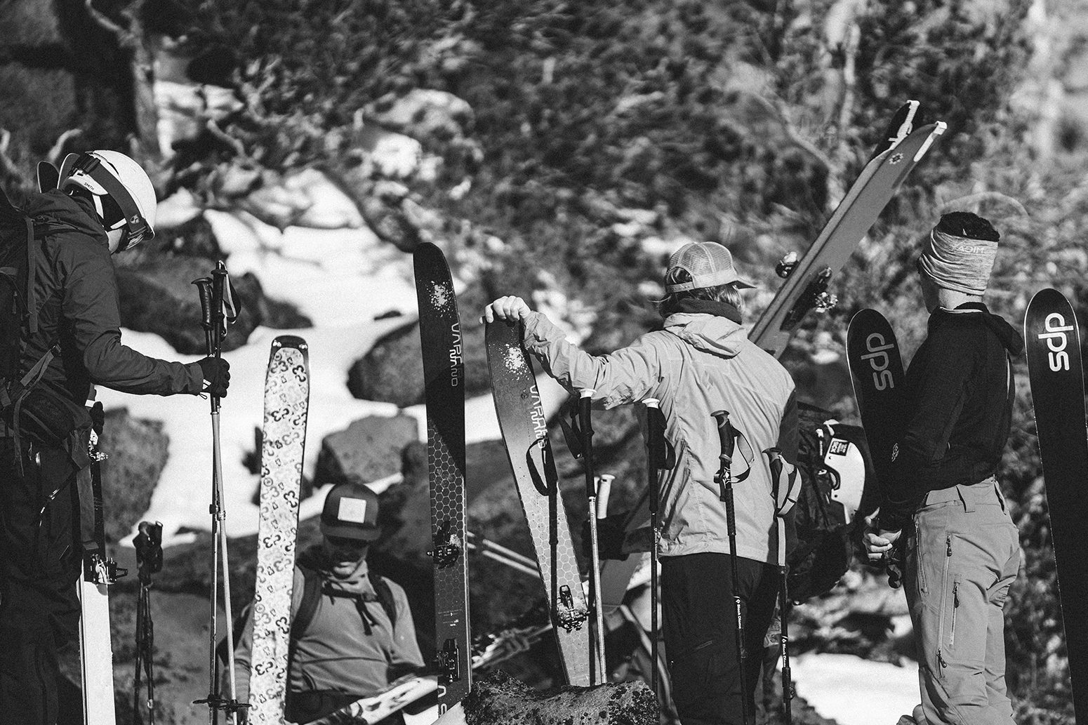 People gathered with skiing equipment