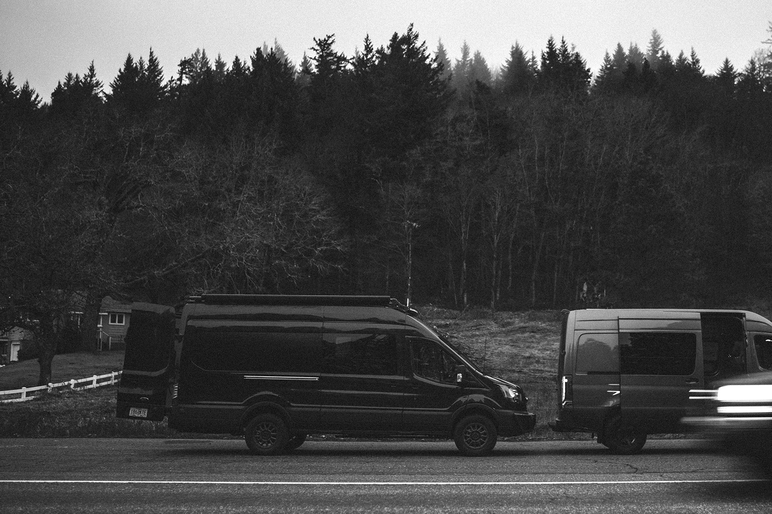 Twp sprinter vans on the side of the road